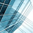Transparent glass wall of office building — Stock Photo #25426681