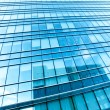 Transparent glass wall of office building — Stock Photo #25427055