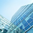 Transparent glass wall of office building — Stock Photo #25427183