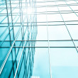 Transparent glass wall of office building — Stock Photo #25427711