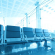 Contemporary blue lounge with seats in the airport - Stock Photo