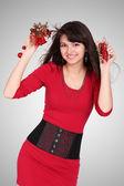 Attractive young girl with christmas vivid presents — Stockfoto
