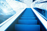 Blue modern escalator in business center — Stok fotoğraf