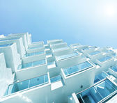 Sunny skyscraper over bright blue sky — Stock Photo