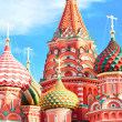 The most famous architectural place for visiting and attraction in Moscow, Russia, Saint Basil's cathedral with colorful cupolas and spectacular domes in traditional culture on cloudy blue sky — Stock Photo #26754031