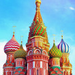 The most famous architectural place for visiting and attraction in Moscow, Russia, Saint Basil's cathedral with colorful cupolas and spectacular domes in traditional culture on cloudy blue sky — Stock Photo #26755489