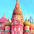 The most famous architectural place for visiting and attraction in Moscow, Russia, Saint Basil's cathedral with colorful cupolas and spectacular domes in traditional culture on cloudy blue sky — Stock Photo #26756515