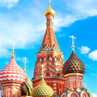 The most famous architectural place for visiting and attraction in Moscow, Russia, Saint Basil's cathedral with colorful cupolas and spectacular domes in traditional culture on cloudy blue sky — Stock Photo #26756555