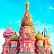 The most famous architectural place for visiting and attraction in Moscow, Russia, Saint Basil's cathedral with colorful cupolas and spectacular domes in traditional culture on cloudy blue sky — Stock Photo #26756657