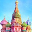 The most famous architectural place for visiting and attraction in Moscow, Russia, Saint Basil's cathedral with colorful cupolas and spectacular domes in traditional culture on cloudy blue sky — Stock Photo #26758385