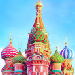 The most famous architectural place for visiting and attraction in Moscow, Russia, Saint Basil's cathedral with colorful cupolas and spectacular domes in traditional culture on cloudy blue sky — Stock Photo