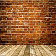 Background of aged grungy textured white brick and red stone wall with light wooden floor with whiteboard inside old neglected and deserted empty interior, blank horizontal space of clean studio room — Stock Photo #26758469