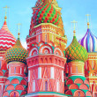 The most famous architectural place for visiting and attraction in Moscow, Russia, Saint Basil's cathedral with colorful cupolas and spectacular domes in traditional culture on cloudy blue sky — Stock Photo #26758509