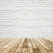 Background of aged grungy textured white brick and red stone wall with light wooden floor with whiteboard inside old neglected and deserted empty interior, blank horizontal space of clean studio room — Stock Photo #26758675