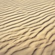 Puckered texture of sand beach — ストック写真