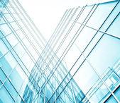 Vista panoramica e prospettico grandangolare all'acciaio sfondo azzurro di vetro alto edificio grattacielo commerciale moderno della città del futuro. Concetto di business di successo architettura industriale — Foto Stock