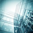 Panoramic and prospective wide angle view to steel light blue background of glass high rise building skyscraper commercial modern city of future. Business concept of successful industrial architecture — Stock Photo #45700449
