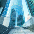Panoramic and prospective wide angle view to steel light blue background of glass high rise building skyscraper commercial modern city of future. Business concept of successful industrial architecture — Stock Photo #45701893