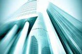 Panoramic and prospective wide angle view to steel light blue background of glass high rise building skyscraper commercial modern city of future. Business concept of successful industrial architecture — Stock Photo