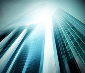 Panoramic and prospective wide angle view to steel light blue background of glass high rise building skyscraper commercial modern city of future. Business concept of successful industrial architecture — Stockfoto