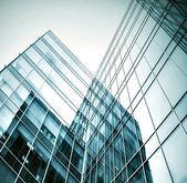 Panoramic and prospective wide angle view to steel light blue background of glass high rise building skyscraper commercial modern city of future. Business concept of successful industrial architecture — Foto Stock