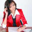 Attentive businesswoman signing document — Stock Photo #6970025