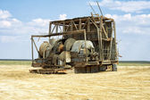 Old winch with a drilling rig. — Stock Photo