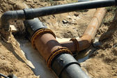 Plastic pipes in the ground. — Stock Photo