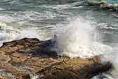 Waves breaking on the rocks. — Stock Photo