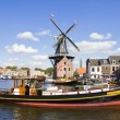 Stock Photo: Windmill and boat, Haarlem, Netherlands
