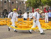 Carriers walking with many cheeses in Alkmaar, Holland — Stock Photo