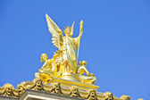 Golden statue in the Opera Garnier, Paris, France — Stock Photo