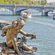 Statue of a cherub on the bridge Alexandre III in Paris, France — Stock Photo
