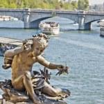 Statue of a cherub on the bridge Alexandre III in Paris, France — Stock Photo