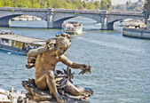 Statue of a cherub on the bridge Alexandre III in Paris, France — Стоковое фото