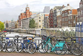 Amsterdam canal and bikes — Stock Photo