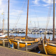 Old boats in the port of Volendam, The Netherlands - Stock Photo