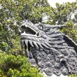 Dragon detail on the roof in Yuyuan Garden — Stock Photo #8680402