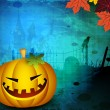 Royalty-Free Stock Vector Image: Halloween pumpkin on grungy backgrond with autumn leaves. EPS 10