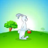 Söt påskhare med påsk ägg korg på natur bakgrund. — Stockvektor