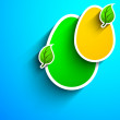 Paper Easter eggs with green leaves on blue background. - Stockvectorbeeld