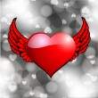 Red heart shape with wings  on grey abstract background. — Stockvectorbeeld
