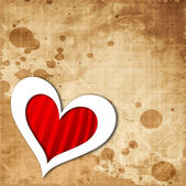 Heart shape on grungy brown background — Vector de stock