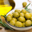 Green olives and oil - Stock Photo