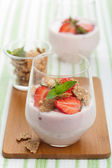 Strawberry yogurt with cornflakes and mint — Stock Photo