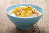 Cereal with caramelized apple — Stock Photo