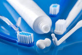 Various toothbrushes and paste — Stock Photo