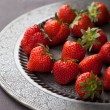 Stock Photo: Strawberry on vintage plate