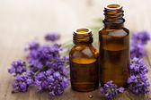 Essential oil and lavender flowers — Stockfoto