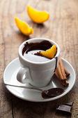 Hot chocolate with orange and cinnamon — Stock Photo